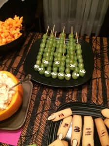 Caterpillar Grapes [Grill skews, green grapes, a dab of frosting, and candy eyes OR mini chocolate chips]