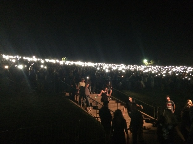 The lawn seats all lit up with phones/lighters.